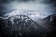 Snow covered mountain and valley Stock Images