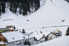 Snow-covered mountain village at the foot of the mountain in winter afternoon, ski resort Isch royalty free stock photography