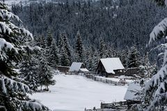 Snow covered mountain wooden cabin. Snow covered mountain wooden hut. Chalet in the mountains at winter Royalty Free Stock Photos