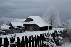 Snow covered mountain wooden hut. Cottage in the mountains at winter Royalty Free Stock Images