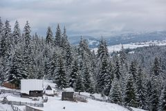 Snow covered mountain wooden hut. Cottage in the mountains at winter Royalty Free Stock Photos