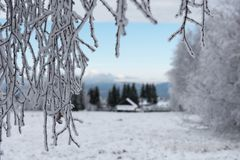 Snow covered mountain wooden hut. Cottage in the mountains at winter Stock Photography