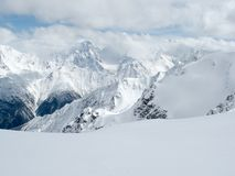 Snow covered mountains. A background of snow covered mountains Stock Image
