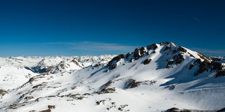 Snow covered mountains. In swiss alps Royalty Free Stock Images