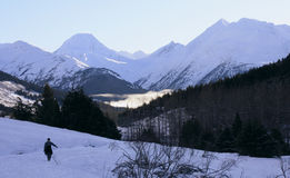Snow covered mountains. A landscape background of snow covered mountains Stock Photography