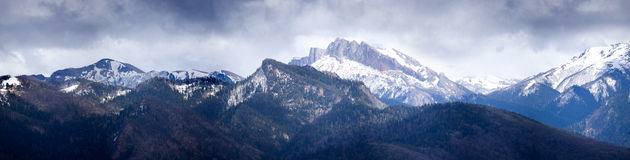 Snow-covered mountains. Under the dark sky Royalty Free Stock Photo