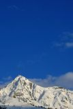 Snow covered mountains. With a blue sky Royalty Free Stock Photography