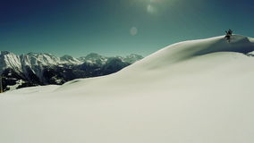 Snow covered mountains aerial view fly over winter landscape stock video