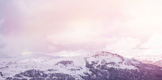 Snow covered mountains against cloudy sky. Scenic view of snow covered mountains against cloudy sky Royalty Free Stock Image