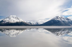 Snow covered mountains. Alaska snow covered mountains at low tide on the Turnagain Arm Girdwood Alaska May 2017 Stock Images