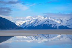 Snow covered mountains. Alaska snow covered mountains at low tide on the Turnagain Arm Girdwood Alaska May 2017 Royalty Free Stock Photography