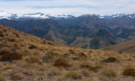 Snow covered mountains as seen from the top of the Ben Lomond Peak near Queenstown, New Zealand. Snow covered mountains as seen from the top of the Ben Lomond royalty free stock photography