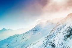 Snow-covered mountains Stock Photos