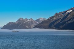 Snow covered mountains and clear blue skies royalty free stock images