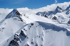 Snow-covered mountains with snow cornice Royalty Free Stock Image