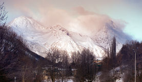 Snow-covered Mountains. French  village  in the  mountains Royalty Free Stock Photos