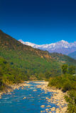 Snow covered mountains in india. River ganga turns near blue in winter . The green around the mountains look so amazing . Himalaya is amazing as always royalty free stock photos