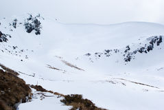 Snow covered mountains at Kepler Track Stock Photo