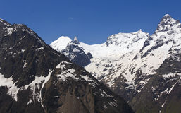 Snow-covered mountains near Dombay meadow.The Caucasus. Stock Photography