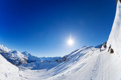 Snow-covered mountains panorama with ski slopes Stock Image