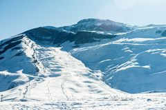 Snow covered mountains peaks, winter mountains. Landscape Royalty Free Stock Image