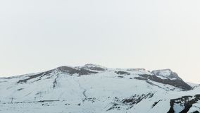 Snow covered mountains peaks, winter mountains. Landscape Royalty Free Stock Images