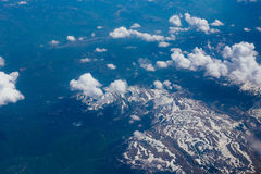 Snow-covered mountains of the plane Royalty Free Stock Image