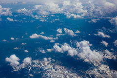 Snow-covered mountains of the plane Stock Photo
