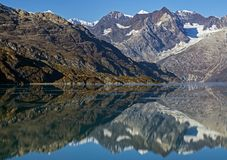 Reflections-Glacier Bay,Alaska,USA. Snow covered Mountains reflecting in ice covered water in Glacier Bay,Alaska,USA Royalty Free Stock Image