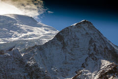 Snow covered mountains and rocky peaks in the Alps Stock Photos