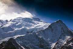 Snow covered mountains and rocky peaks in the Alps Royalty Free Stock Photo