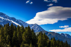 Snow covered mountains and rocky peaks in the Alps Stock Images