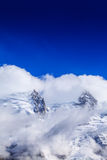 Snow covered mountains and rocky peaks in the French Alps Royalty Free Stock Photos