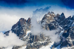 Snow covered mountains and rocky peaks in the French Alps Stock Photography
