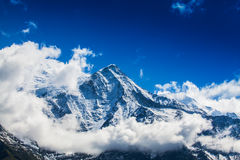 Snow covered mountains and rocky peaks in the French Alps Royalty Free Stock Photography