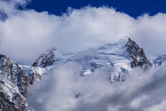 Snow covered mountains and rocky peaks in the French Alps Stock Photos