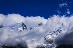 Snow covered mountains and rocky peaks in the French Alps Royalty Free Stock Images
