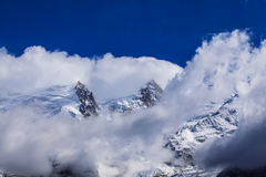 Snow covered mountains and rocky peaks in the French Alps Royalty Free Stock Photo