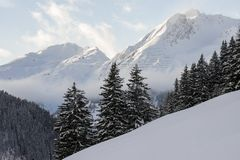 Snow covered mountains seen from the Fluela Pass Strasse stock images