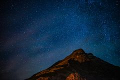 Snow-covered mountains of the starry sky and Iceland stock photos