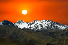 Snow Covered Mountains, Sunrise, Sunset Royalty Free Stock Photo