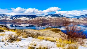 Snow Covered Mountains surrounding Kamloops Lake in central British Columbia, Canada. On a cold and crisp Winter Day under a blue sky Stock Photos