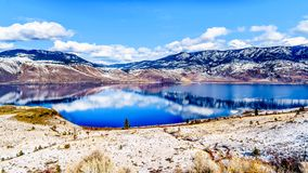 Snow Covered Mountains surrounding Kamloops Lake in central British Columbia, Canada. On a cold and crisp Winter Day under a blue sky royalty free stock photos