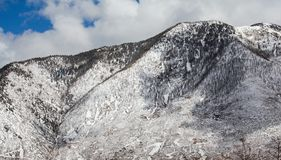 Snow covered mountainside. stock photo