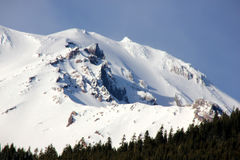 Snow covered Mt. Shasta Peak with human face Royalty Free Stock Photo