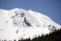 Snow covered Mt. Shasta Peak with human face Royalty Free Stock Images