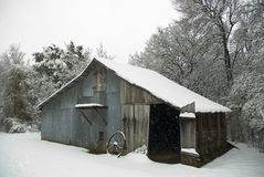 Snow covered old barn Stock Images