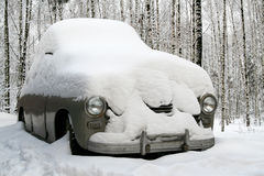 Snow covered old car Royalty Free Stock Image