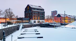 Snow-covered Old Mill hotel in the winter time. Royalty Free Stock Photo