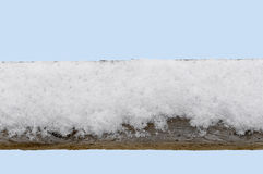 Snow covered old wood fence railing close up Stock Photos
